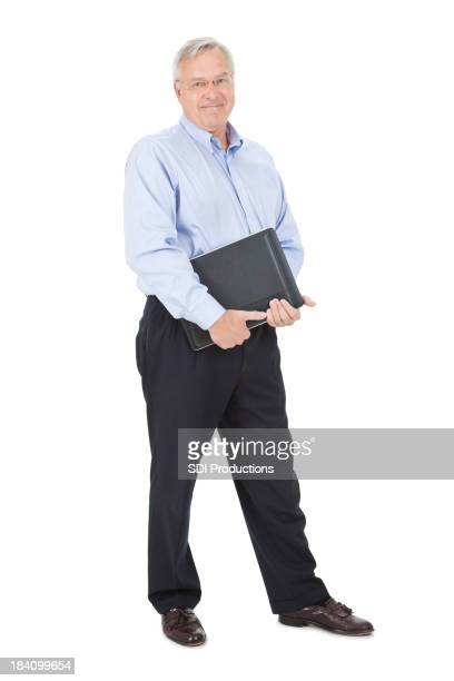 Happy Mature Adult Man With Laptop and Work Binder