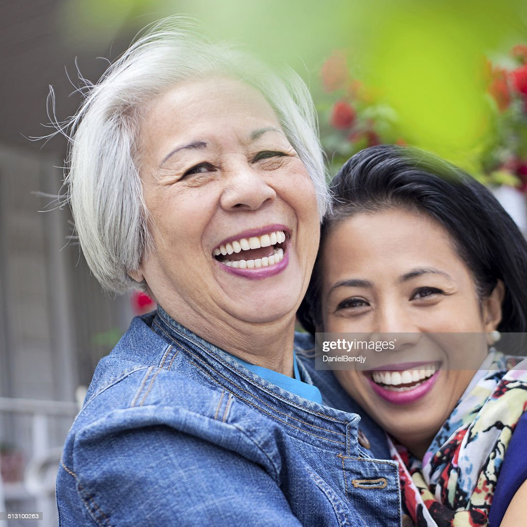 happy mature asian woman daughter stock photo | getty images