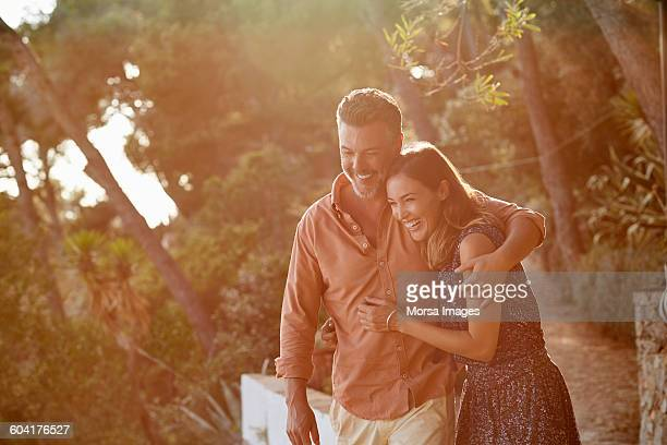 Happy mature couple embracing each other in forest