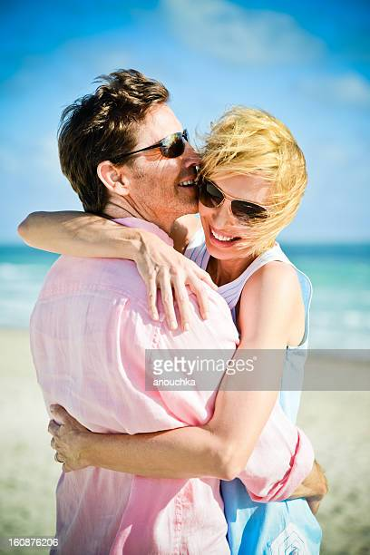 Happy Mature Couple embracing on the beach