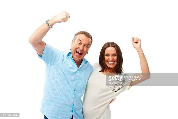 Happy mature couple enjoying success