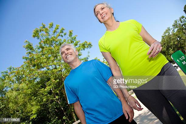 Happy Mature Couple Exercising Outdoors Together