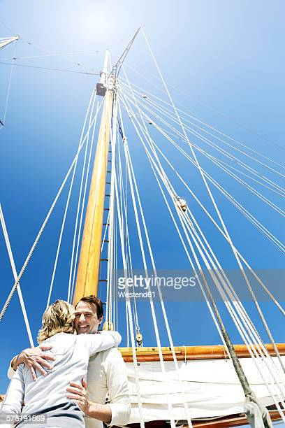 Happy mature couple hugging on a sailing ship