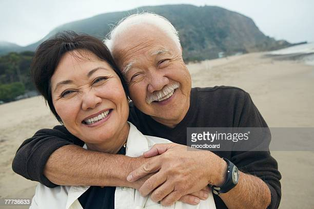 Happy Mature Couple Hugging on Beach