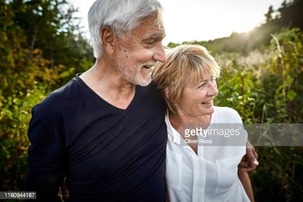 happy mature couple in the countryside - travel stock-fotos und bilder