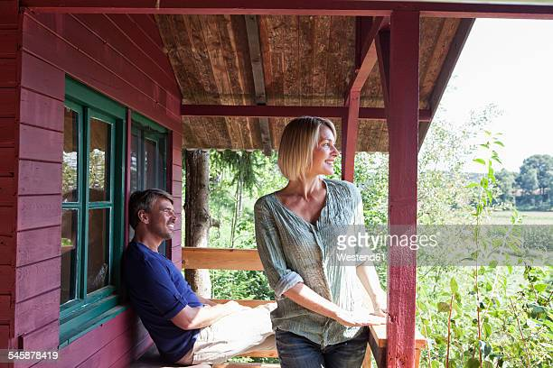 Happy mature couple on porch of summer house