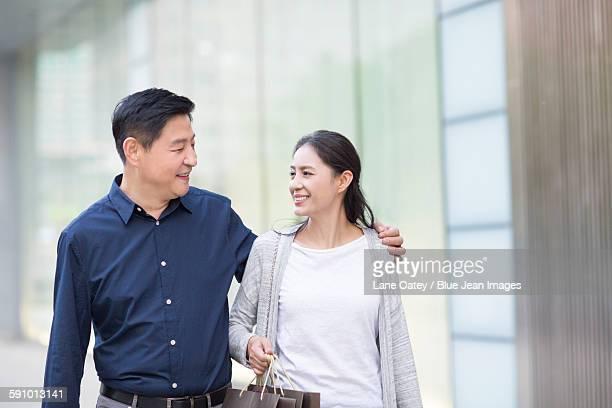 Happy mature couple shopping