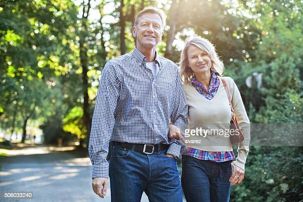 Happy mature couple walking in a park