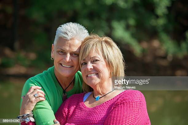 happy mature female couple embrace