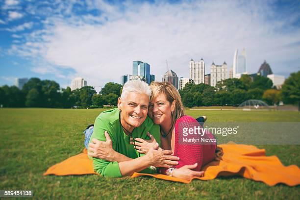 happy mature female couple - piedmont park atlanta georgia stock pictures, royalty-free photos & images