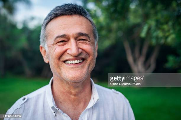 happy mature male man smiling - middle east stock pictures, royalty-free photos & images