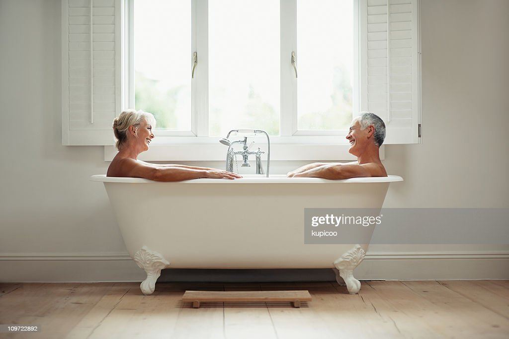 Senior Couple In Bath Together Smiling Stock Photo | Getty Images