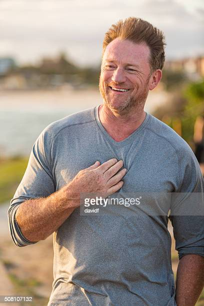 Happy Mature Man Jogger By the Seaside After Exercising
