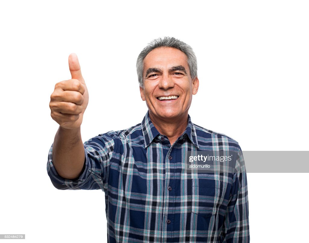 happy mature man showing thumbs up stock photo | getty images