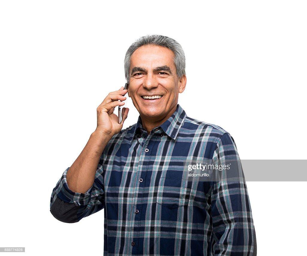 Felice uomo maturo parlando al cellulare : Foto stock