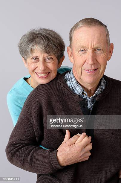 happy, mature married couple holding hands - 40th anniversary stock pictures, royalty-free photos & images