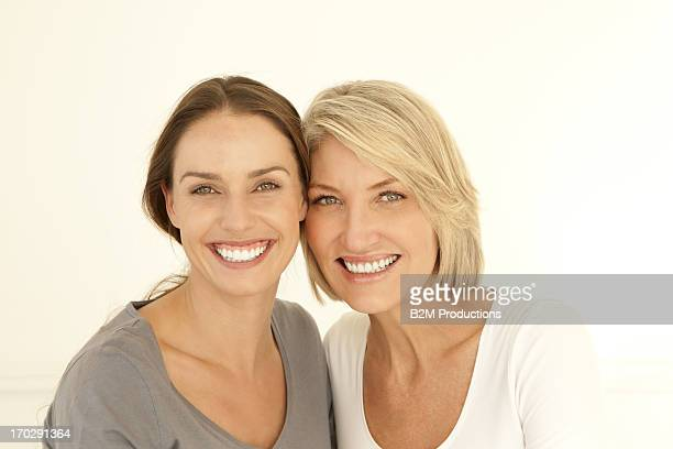 happy mature mother and young daughter - hazel bond stock photos and pictures
