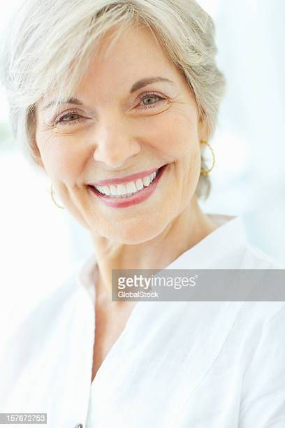 Happy mature woman giving you a cute smile