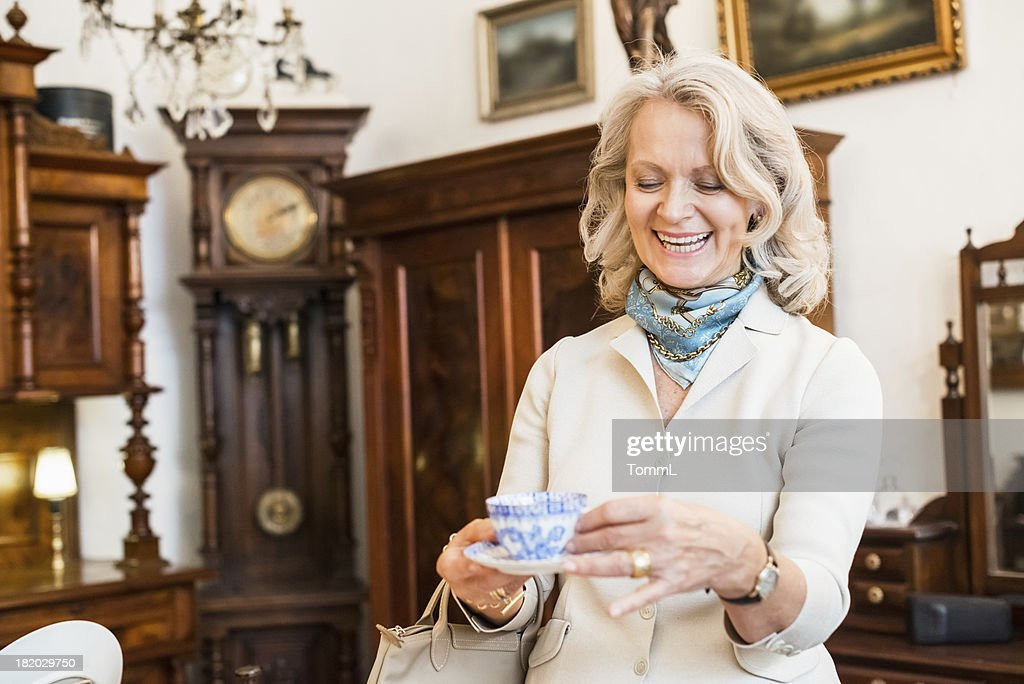 Happy Mature Woman in Antique Store : Stock Photo
