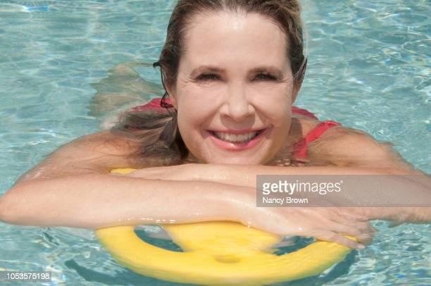 happy mature woman wet head shot