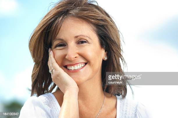 happy mature woman outdoors - cheek stock pictures, royalty-free photos & images