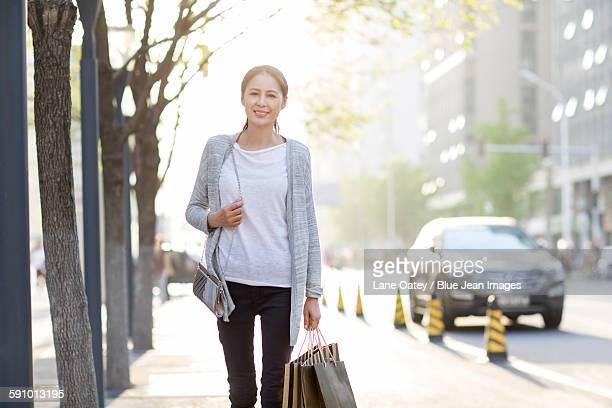Happy mature woman shopping