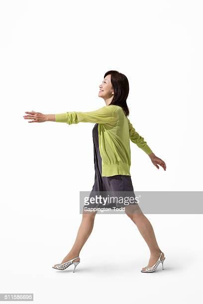 Happy Mature Woman Walking