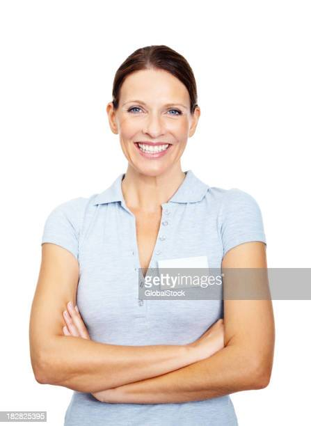 Happy mature woman with blank name tag against white