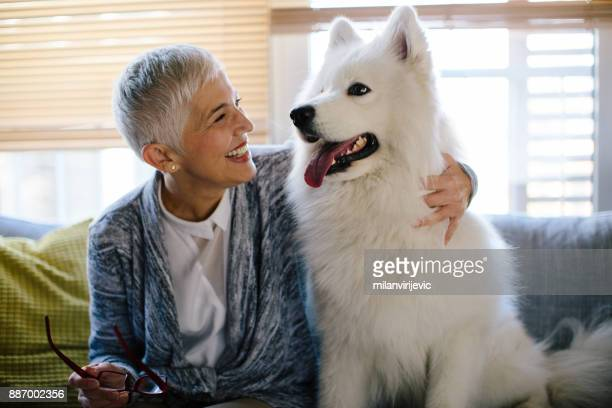 Happy mature woman with her dog