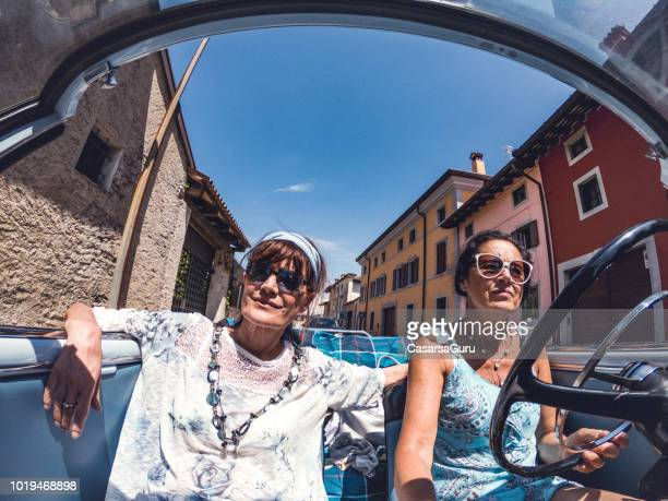 happy mature women on a road trip together - vintage lesbian photos stock pictures, royalty-free photos & images