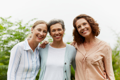 Happy mature women standing in park - gettyimageskorea