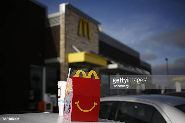 A Happy Meal box sits on top of a customer's vehicle outside a McDonald's Corp fast food restaurant in White House Tennessee US on Wednesday Jan 18...