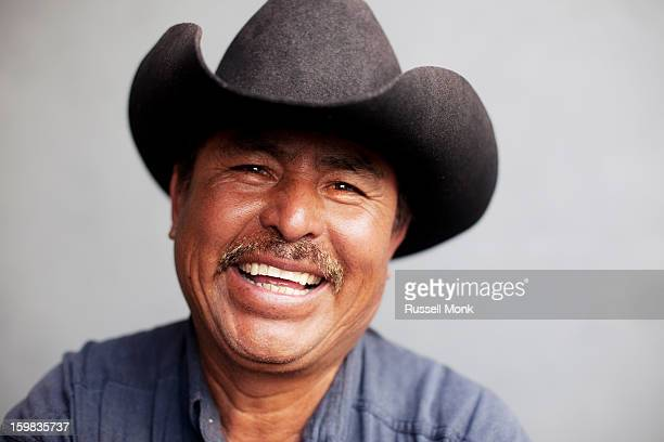 Happy mexican man wearing a cowboy hat.