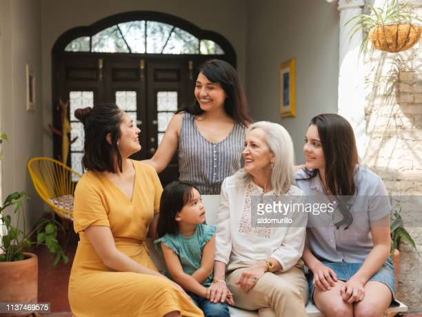 happy mexican women smiling at each other - mexican mothers day stock photos and pictures