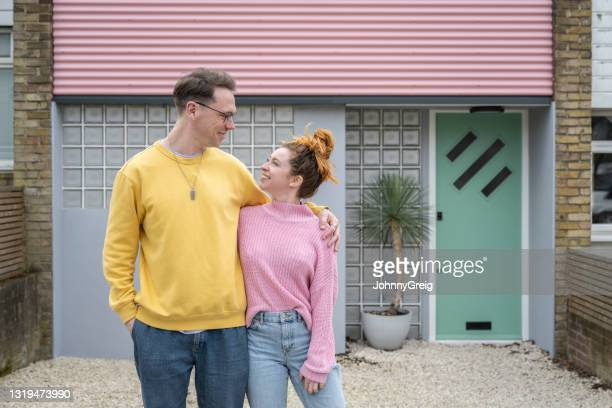 happy mid 30s caucasian home owners - mid adult couple stock pictures, royalty-free photos & images