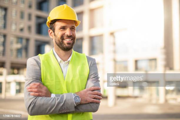 happy mid adult engineer. - real estate developer stock pictures, royalty-free photos & images