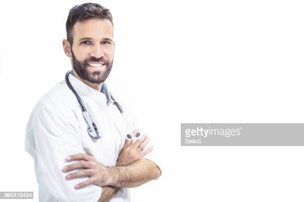 happy mid adult male doctor looking at camera on white background. - handsome doctors stock pictures, royalty-free photos & images