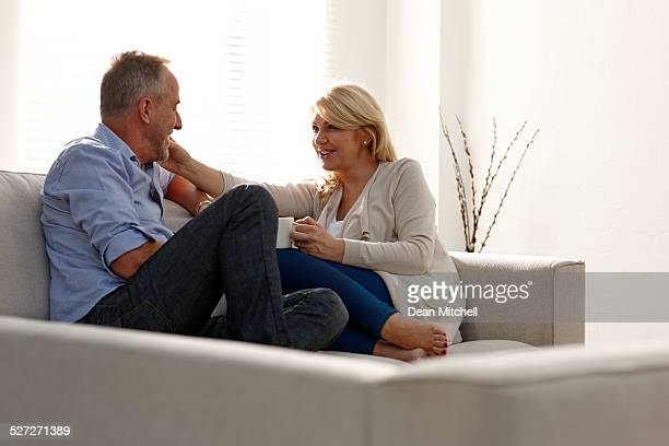 Happy middle aged couple on sofa