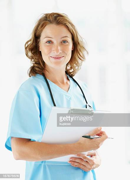 Happy middle aged female doctor holding notepad