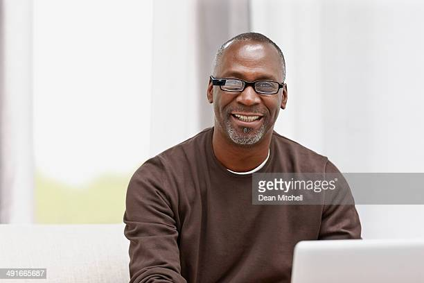 happy middle aged male using latest technology - most handsome black men stock photos and pictures