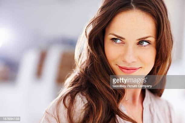 happy middle aged woman looking away - mid adult women stock pictures, royalty-free photos & images