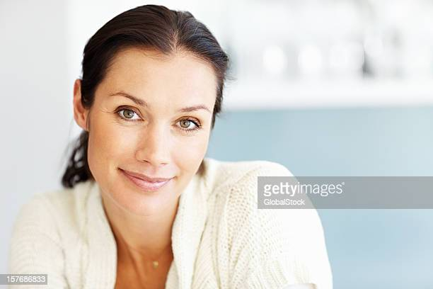 Happy, middle aged woman smiling against blur