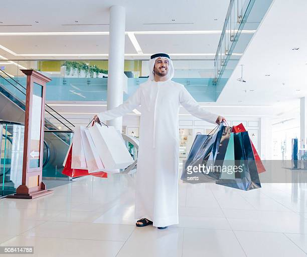Happy Middle Eastern Man with Shopping Bags