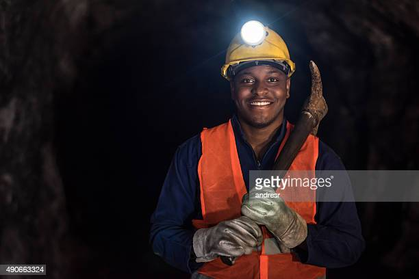 happy miner working at a mine underground - coal miner stock photos and pictures