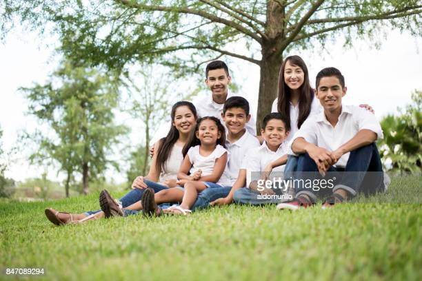 Happy mixed group of children and teenagers smiling at camera