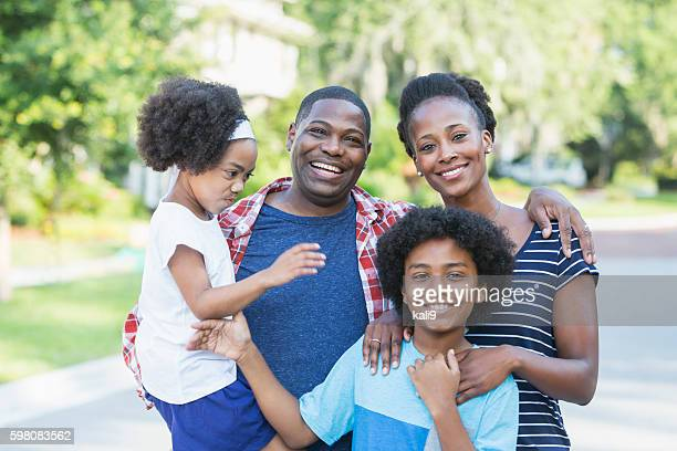 Happy mixed race African American family, mischief