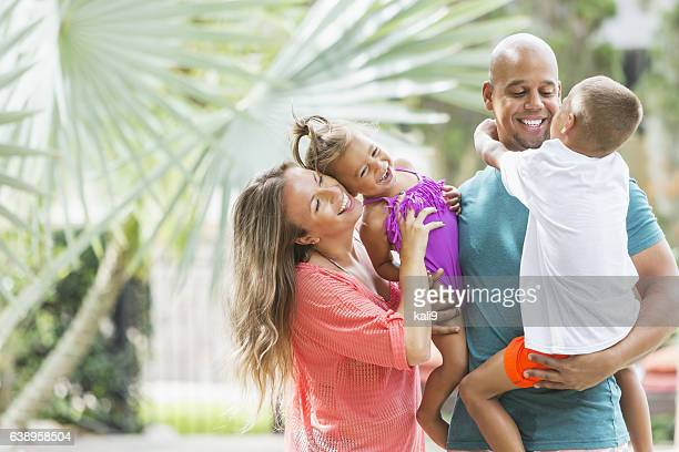 Happy mixed race family on tropical vacation
