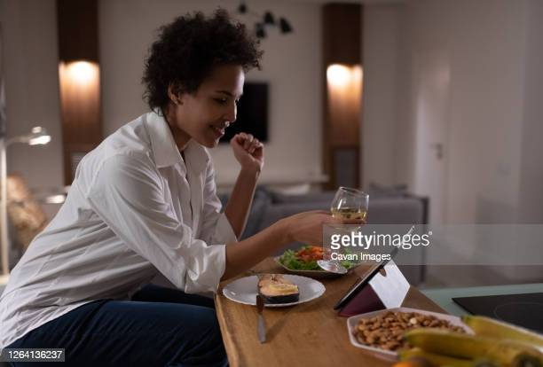 happy mixed race woman proposing toast during online date - romance stock pictures, royalty-free photos & images