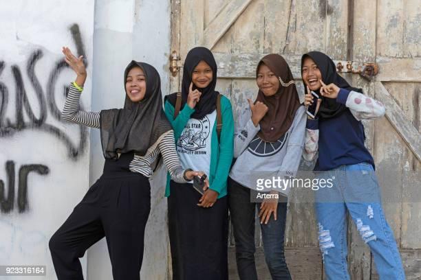 Happy modern dressed young Indonesian girls wearing jilbab hijab Semarang Java Indonesia