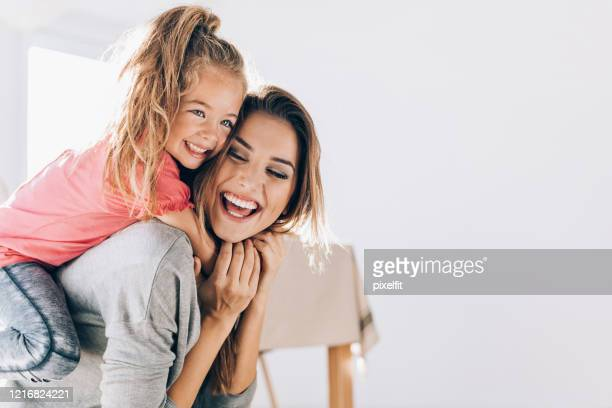 happy mom carrying her little daughter - mother stock pictures, royalty-free photos & images